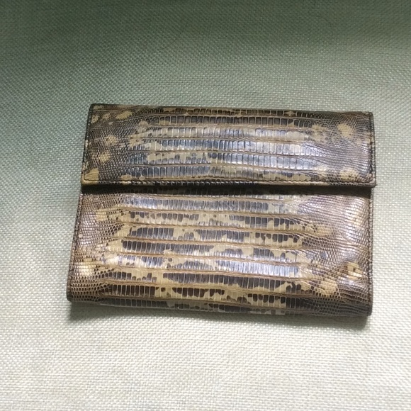 7095a9e40407 Prada snakeskin and leather wallet. M_5ac7a7ac2ab8c5d435c53c3f